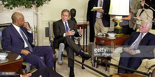 President George W Bush speaks with Secretary of Education Rod Paige and Sen Edward Kennedy 02 August 2001 as House and Senate Education leaders...