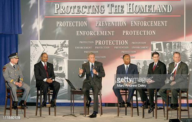 President George W Bush spoke alongside a local panel of John Moslow of the Amherst Police Department Mike Battle Larry Thompson Jim McMahon and...