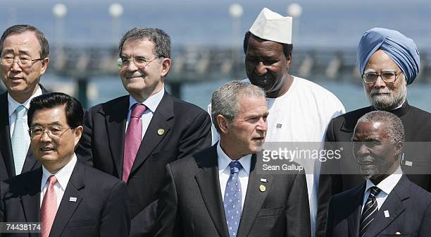S President George W Bush stands at a group photo with Chinese President Hu Jintao and South African President Thabo Mbeki and SecretaryGeneral of...
