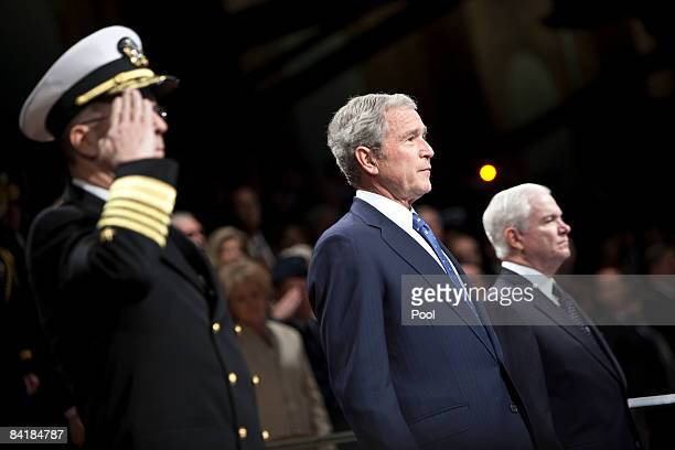 US President George W Bush stands by Robert Gates Secretary of Defense right and Admiral Michael Mullens Chairman of the Joint Chiefs of Staff during...