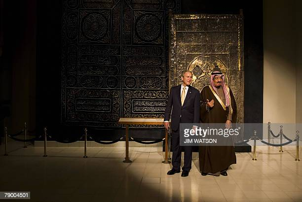US President George W Bush stands in front of a Ka'aba door curtain with Prince Salman bin Abdul Aziz the brother of the Saudi king and Governor of...