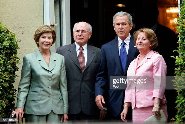 S President George W Bush stands outside after a Sunday morning service with first lady Laura Bush Australian Prime Minister John Howard and his wife...