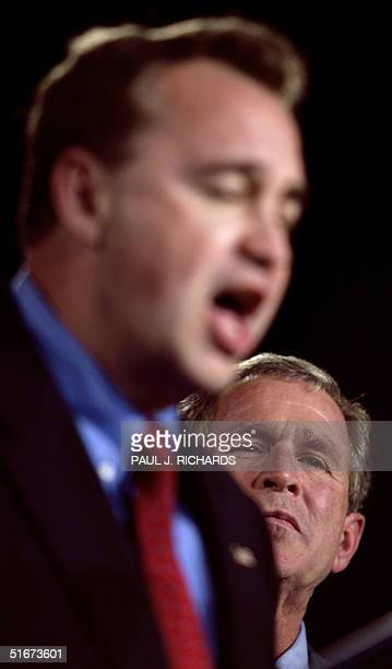 President George W Bush stands with Arizona Republican congressional candidate Rick Renzi during a campaign appearance 27 September 2002 in Flagstaff...
