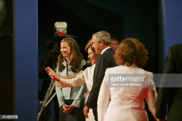 US President George W Bush stands with his family daughter Barbara Bush and first lady Laura Bush after the first presidential debate at the...