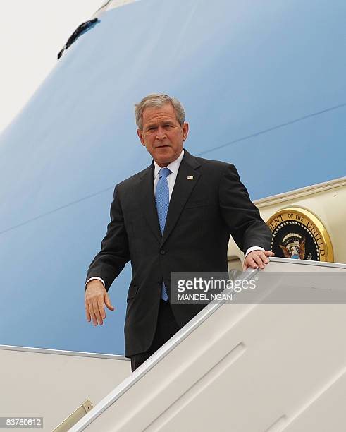 President George W. Bush steps off Air Force One on November 21, 2008 upon arrival at Jorge Chavez International Airport in Lima. Bush is in Lima,...