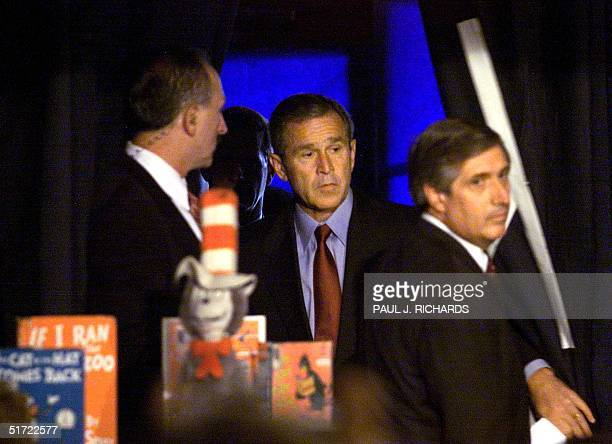 President George W. Bush steps thru the curtain and led by his Chief of Staff Andrew Card to address the nation shortly after news of the New York...