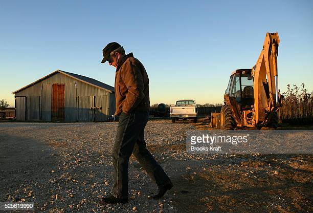 US President George W Bush takes a pensive walk around his ranch in Crawford Texas