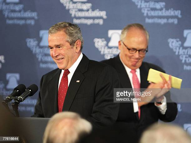 US President George W Bush takes the lectern to speak after being introduced by Heritage Foundation President Edwin J Feulner on the war on terror01...