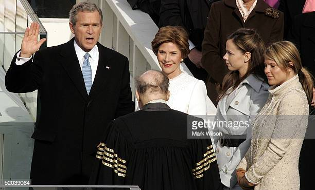 US President George W Bush takes the oath of office from Supreme Court Chief Justice William Rehnquist while first lady Laura Bush Jenna Bush and...