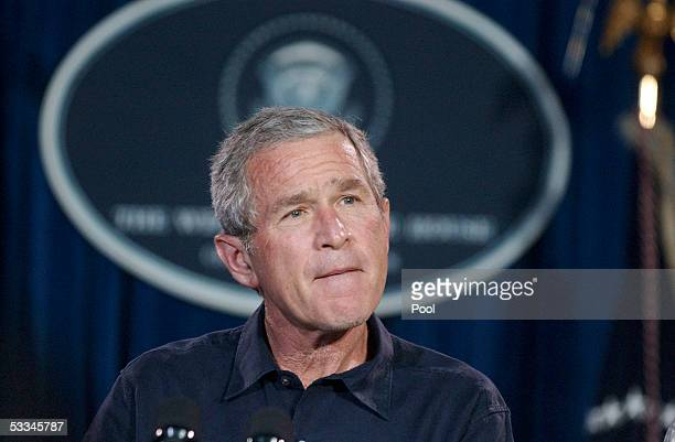 S President George W Bush talks attends a press conference after meeting with his economic team at his ranch August 9 2005 near Crawford Texas Bush...