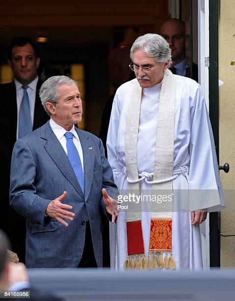 US President George W Bush talks to Reverend Dr Luis Leon as he leaves Sunday service at Saint John's Church on January 4 2009 in Washington DC Bush...