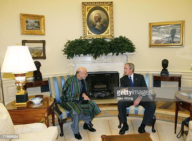 President George W. Bush talks with Afghan President Hamid Kaizai during their meeting in the Oval Office of the White House September 26, 2006 in...