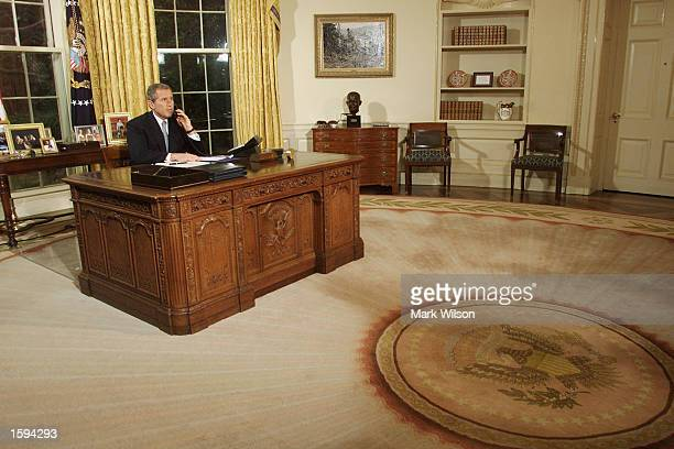 President George W Bush talks with former first lady Nancy Reagan on the telephone after signing a Joint Resolution commemorating Ronald Reagan's...