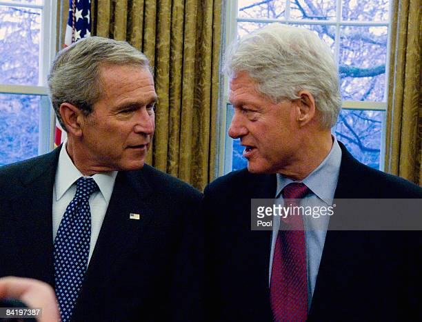 US President George W Bush talks with former President Bill Clinton during a photoop with other former presidents and incoming Presidentelect Barack...