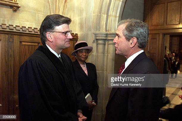 President George W Bush talks with Franklin Graham following the sermon at the Inaugural Prayer Service presented by Graham at the Washington...