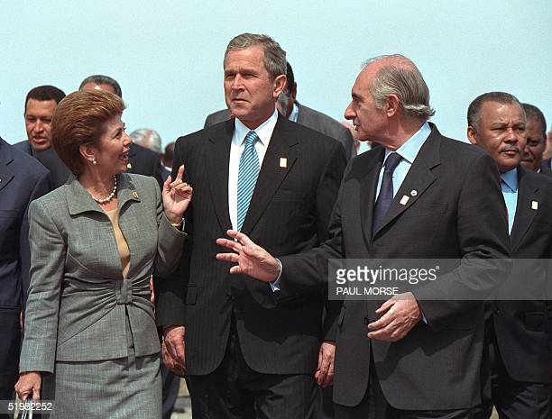 President George W. Bush talks with Panama's President Mireya Moscoso , and Argentina's President Fernando de la Rua prior to the official group...
