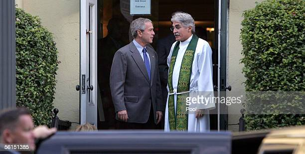 US President George W Bush talks with Reverend Dr Luis Leon rector of St John's Episcopal Church after the sevenfortyfive Sunday Church service...