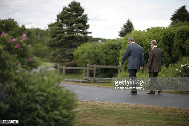 President George W Bush talks with Russian President Vladamir Putin as they tour the grounds at the Bush family house at Walker's Point on July 01...