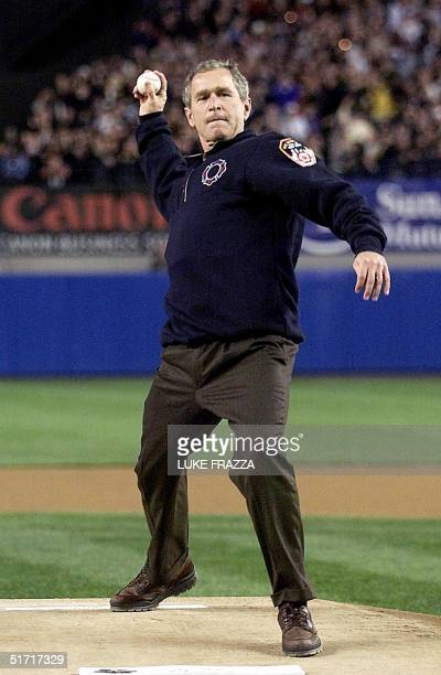 President George W Bush throws out the ceremonial 'first pitch' 30 October at Yankee Stadium in New York City just before the start of the third game...