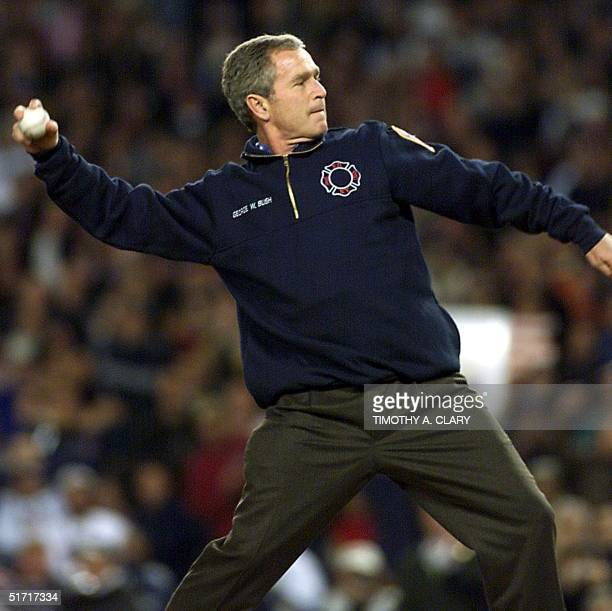 President George W Bush throws the ceremonial first pitch of Game 3 of the World Series in New York's Yankee Stadium 30 October 2001 The Arizona...