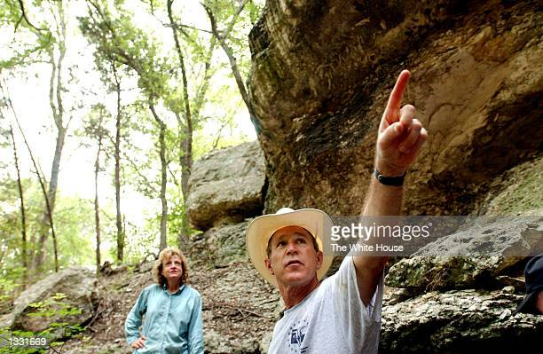 S President George W Bush tours a canyon with White House Staff Secretary Harriet Miers at his ranch August 9 2002 in CrawfordTexas Bush is working...