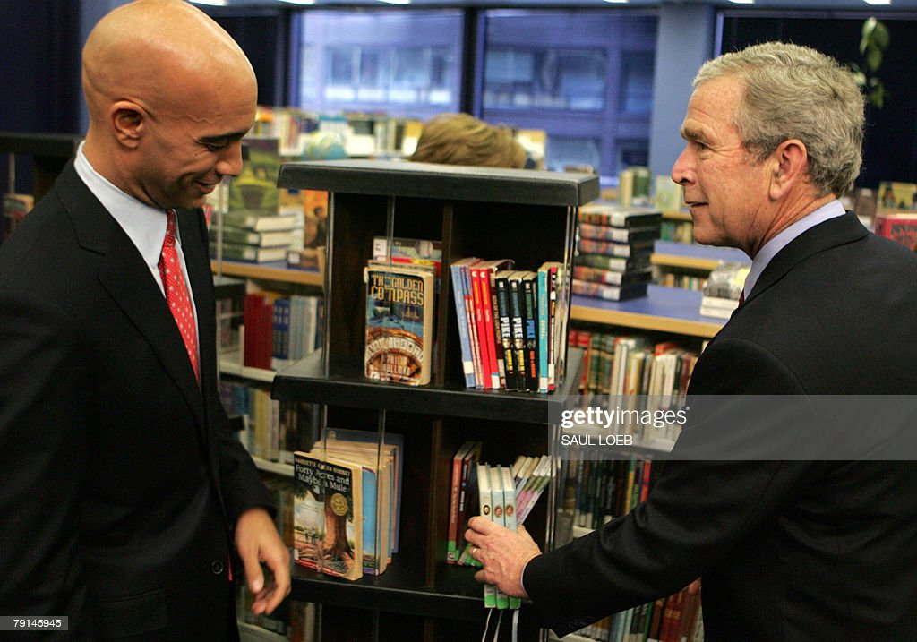 US President George W. Bush (R) tours the Martin Luther King, Jr. Memorial Library with Washington, DC, Mayor Adrian Fenty (L) to observe Martin Luther King, Jr. Day in Washington, DC, 21 January 2008.