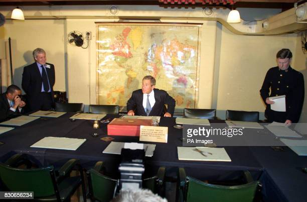 US President George W Bush tries the seat of Winston Churchill in the map room of Churchill's Cabinet War Rooms in London The former The World War II...