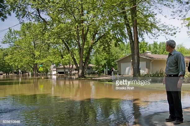 President George W. Bush views flood damage in neighborhood in Iowa City, Iowa.