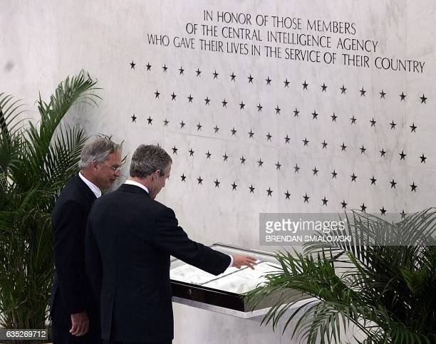 US President George W Bush visits a memorial wall with CIA Director Porter Goss at the headquarters of the Central Intelligence Agency 03 March 2005...