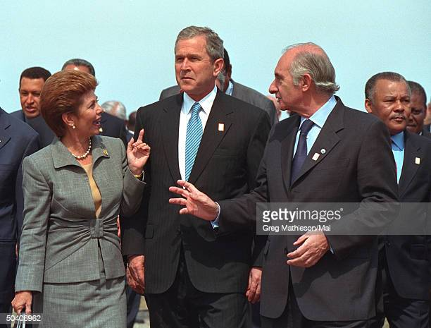 President George W Bush w Panama's President Mireya Moscoso and Argentina's President Fernando de la Rua prior to the offical group photo at the...