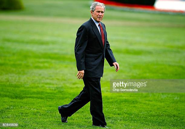 S President George W Bush walks across the South Lawn after arriving back at the White House September 16 2008 in Washington DC Bush just returned...