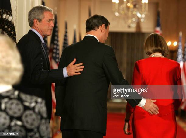 President George W. Bush walks away with John Roberts and his wife, Jane Roberts, after his swearing in ceremony as Chief Justice of the U.S. By...