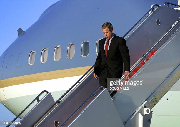 President George W. Bush walks down the steps of Air Force One as he arrives at Andrews Air Force Base 11 September 2001 in Maryland. Bush will...