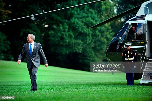S President George W Bush walks from Marine One on the South Lawn of the White House July 25 2008 in Washington DC Bush was returning from Peoria...
