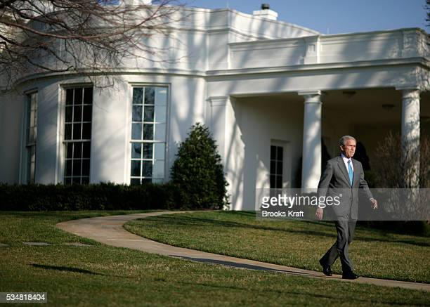 President George W Bush walks from the Oval Office to make a statement on FISA legislation on the South Lawn of the White House in Washington DC