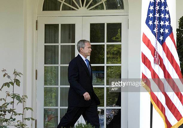 US President George W Bush walks from the oval office to the Rose Garden before he spoke on the status of the US and global economy at the White...