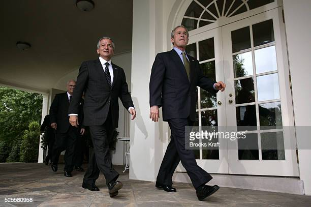 President George W Bush walks from the Oval Office with Honduran President Ricardo Maduro after meetings Thursday May 12 with the presidents from...