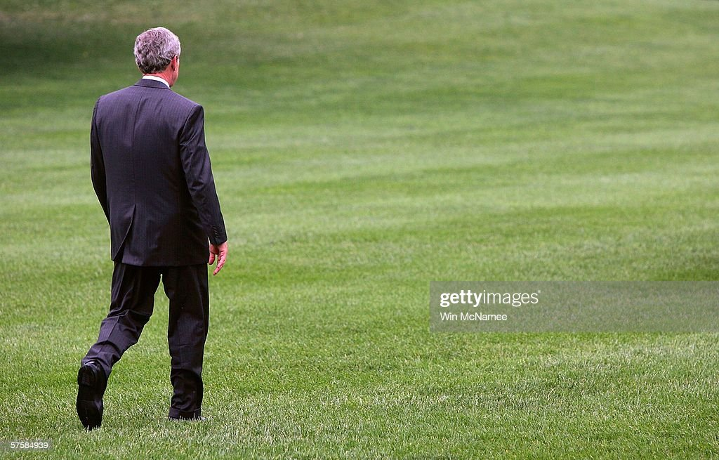 U.S. President George W. Bush walks from the White House to a waiting Marine One helicopter, after making a statement on recent reports about the National Security Agency, May 11, 2006 in Washington, DC. President Bush is traveling to Mississippi.