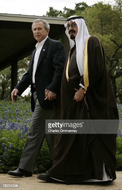 President George W Bush walks handinhand with Saudi Arabia's Crown Prince Abdullah on his ranch April 25 in Crawford Texas Other highranking members...
