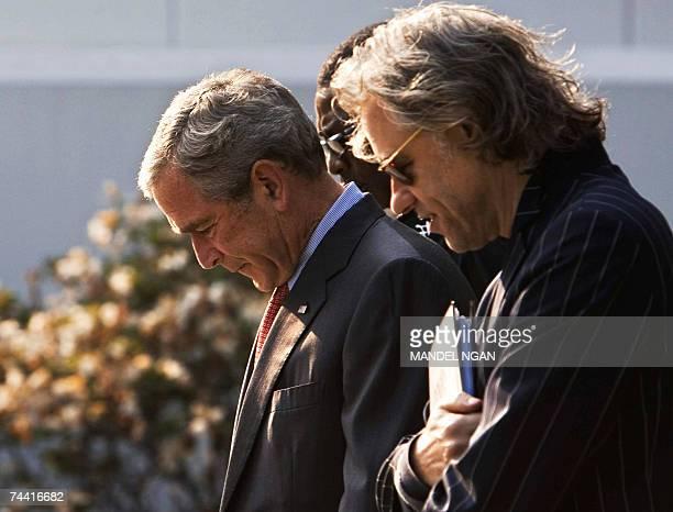 President George W Bush walks Irish political activist Bob Geldof and Senegalese musician Youssou N'Dour 06 June 2007 before a meeting on the Baltic...