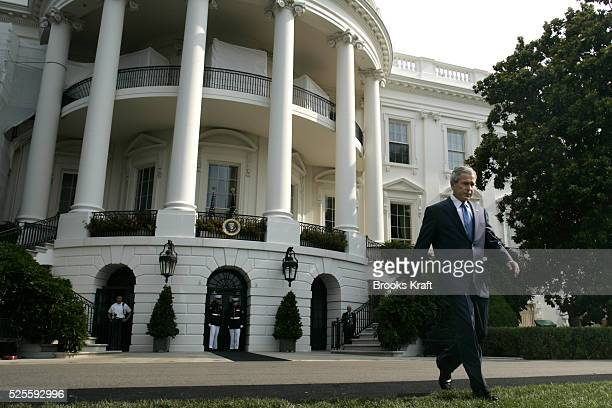 US President George W Bush walks onto the South Lawn of the White House to the Voting Rights Act of 2006 in a ceremony on the South Lawn of the White...