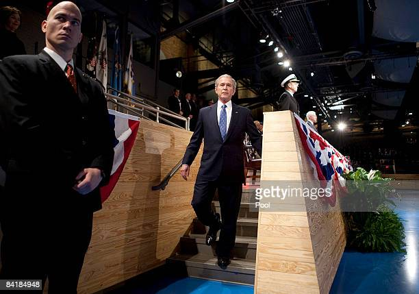 US President George W Bush walks to the parade ground to review the troops during the Military Appreciation Parade at Fort Myer January 6 2009 in...