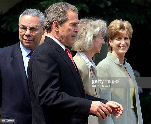 President George W Bush walks to the podium with members of his Cabinet including Secretary of State Colin Powell Secretary of Interior Gale Norton...