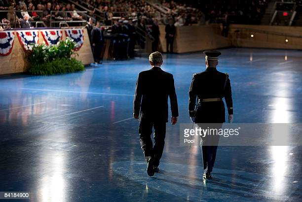 US President George W Bush walks toward the reviewing stand after reviewing the troops during the Military Appreciation Parade at Fort Myer January 6...