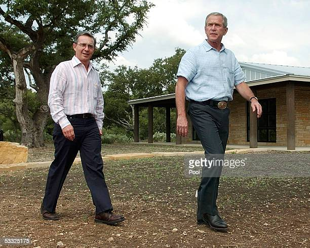 S President George W Bush walks with Columbian President Alvaro Uribe after a joint press conference at his ranch August 4 2005 near Crawford Texas...
