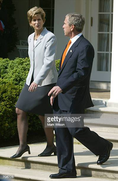 S President George W Bush walks with Environmental Protection Agency Administrator Christie Whitmans during the Presidents Environmental Youth Awards...