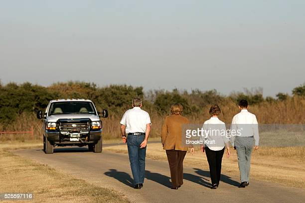 US President George W Bush walks with German Chancellor Angela Merkel first lady Laura Bush and Merkel's husband Dr Joachim Sauer upon their arrival...