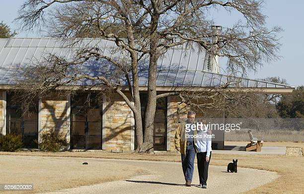 US President George W Bush walks with his wife and First Lady Laura Bush and dog Barney from their home on the Bush Ranch in Crawford Texas
