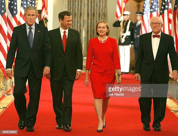 US President George W Bush walks with John Roberts his wife Jane Roberts and Associate Justice John Paul Stevens as they arrive for a ceremony to...