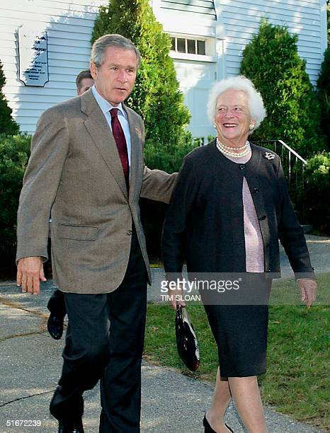 President George W. Bush walks with mother Former First Lady Barbara Bush after attending Sunday Services at the First Congregational Church of...